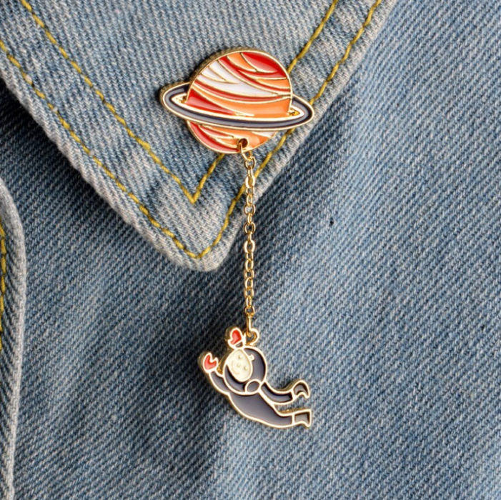 Pin for jacket or clothes of Saturn and an astronaut