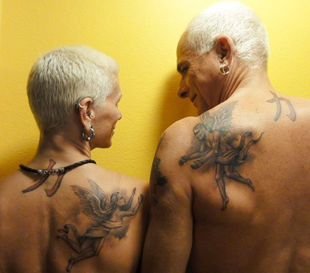 Couple of grandparents sharing their tattoo