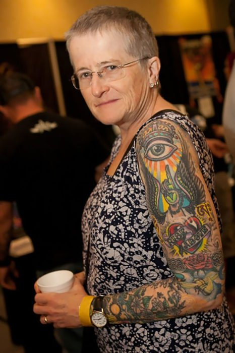 Granny showing her arm covered with tattoos