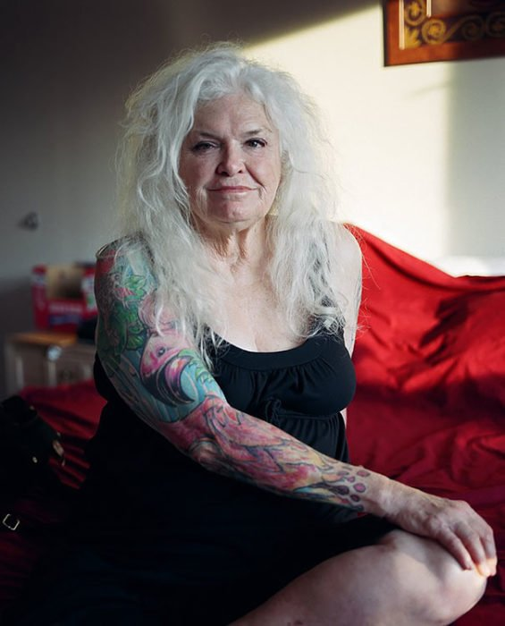 Granny with her arm full of different tattoos
