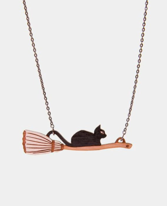 Halloween inspired accessory of a necklace of a witches broom with a black cat on it