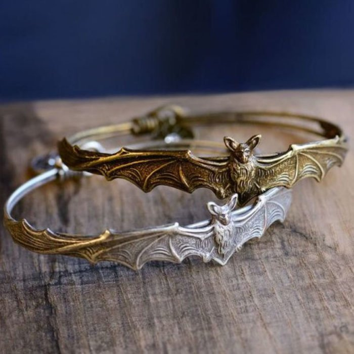 Halloween-inspired accessory of bracelets featuring a bat figure with open wings