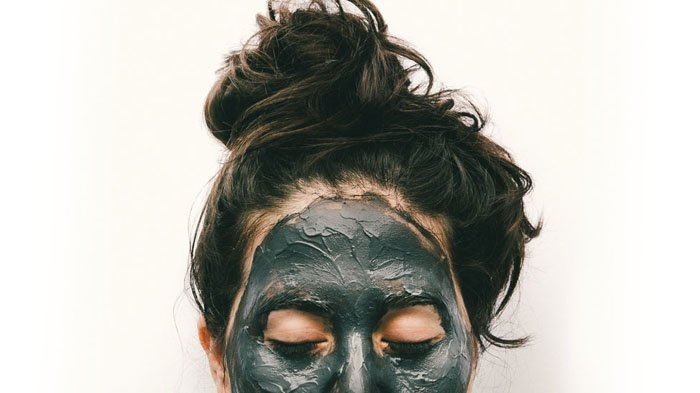 Chia showing her forehead with activated charcoal mask
