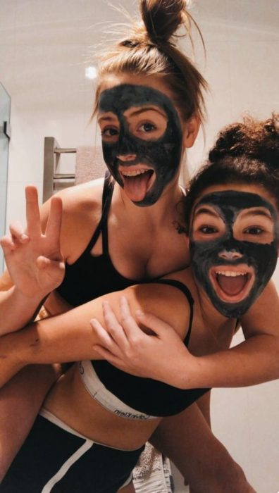 Girls wearing activated charcoal face mask