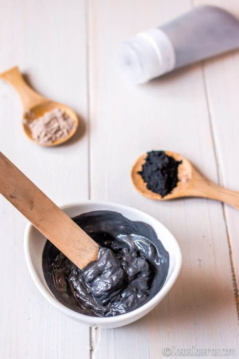 White bowl with activated charcoal face mask