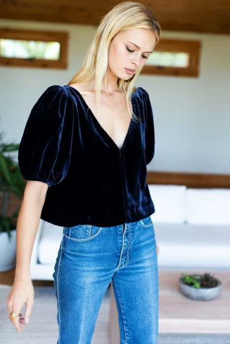Navy blue velvet blouse with V neckline and puffed sleeves
