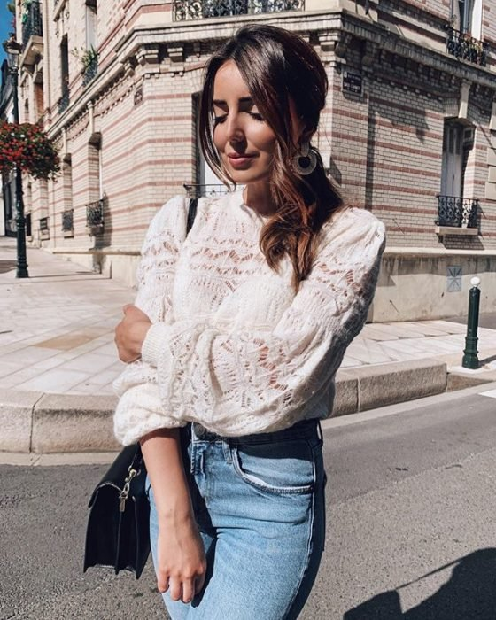 Girl wearing jeans and white blouse with transparencies