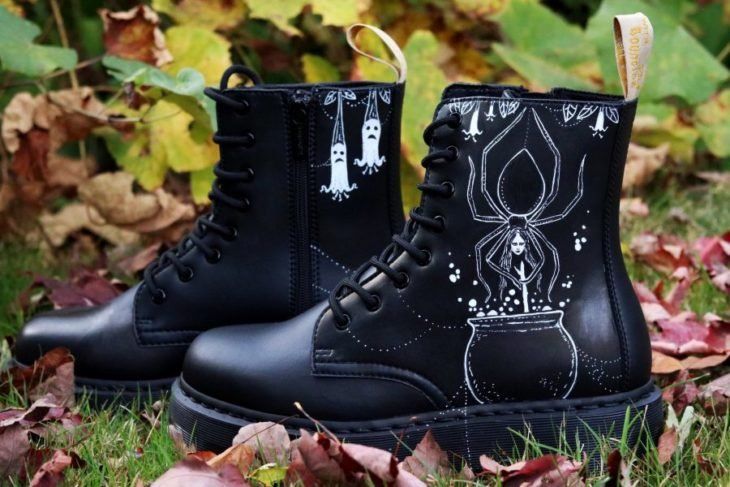Dr. Martens boots in black with spider web pattern