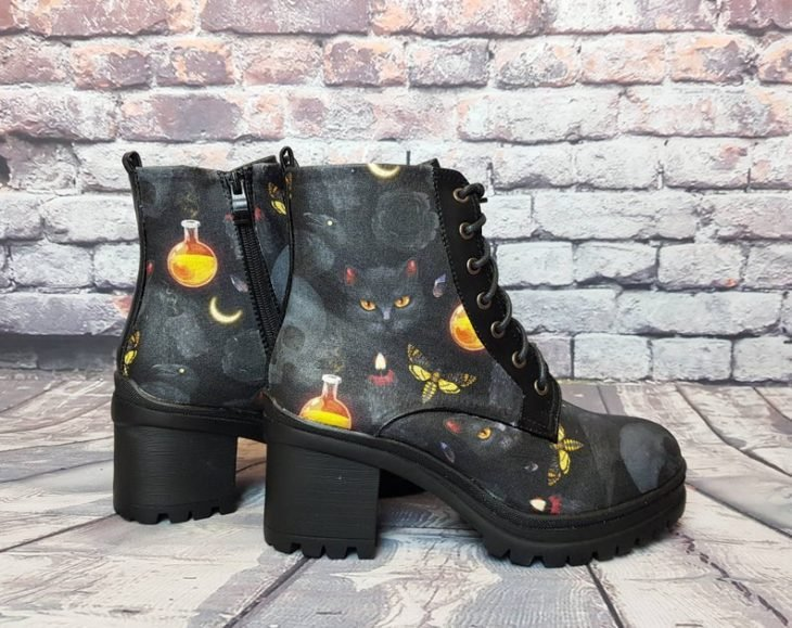 Dr. Martens boots in black with cat and pumpkin print