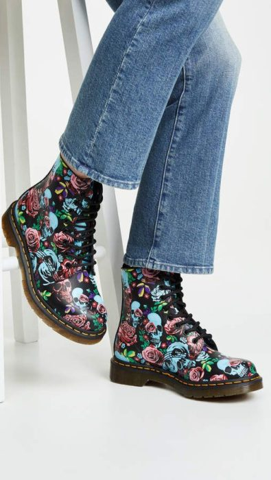 Dr. Martens boots in black with blue and pink skulls print