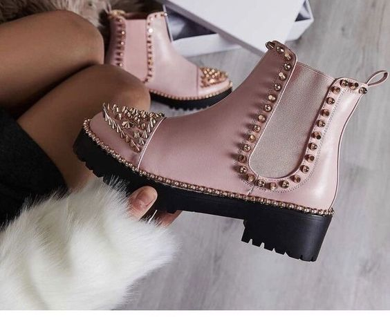 Pink Dr. Martens boots with studs