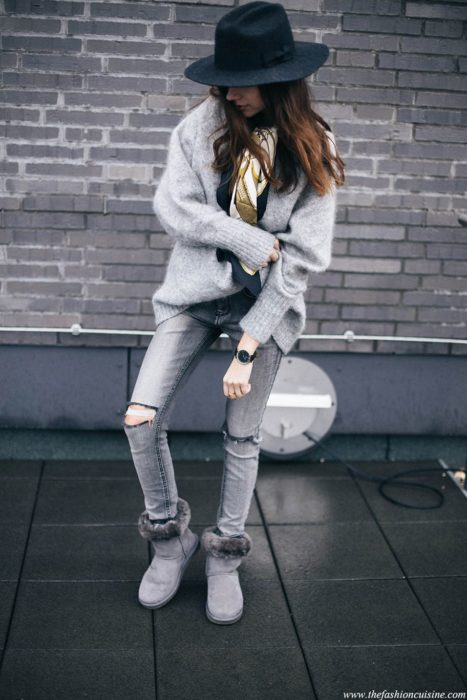 Girl posing for a photo while wearing a gray outfit with ugg boots of the same color