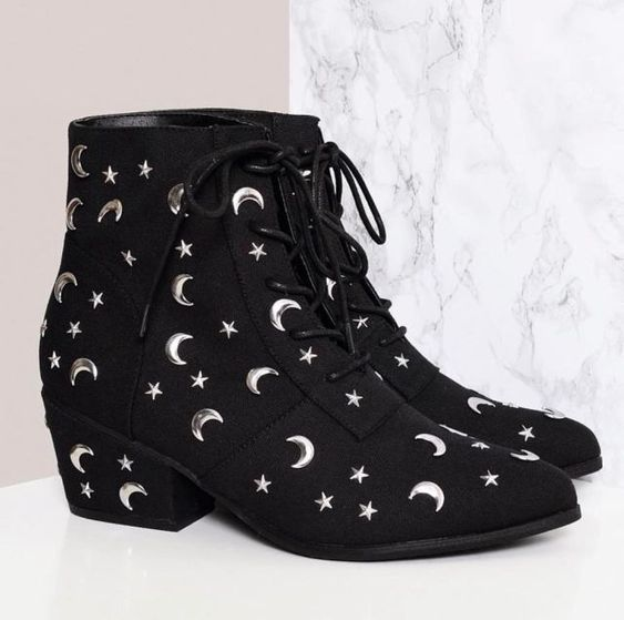 Black lace-up ankle boots with moon and star details