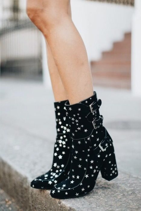 Black ankle boots with belts and silver stars