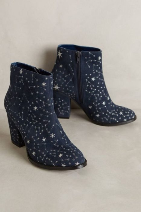 Navy blue ankle boots with gold star details