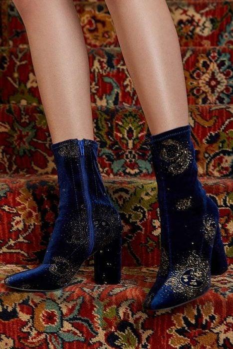 Blue velvet ankle boots with golden star details