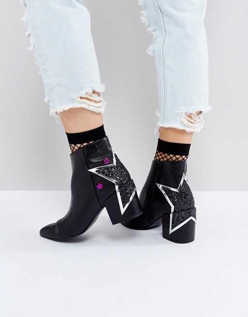 Black ankle boots with stars on the heel