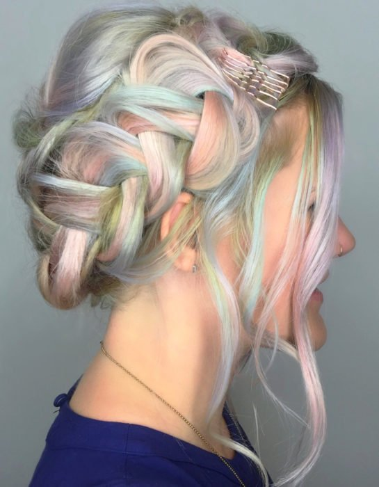 Woman with lavender gray hair and dyed pastel rainbow colors, blue, green, yellow, pink and purple, wide braid crown hairstyle