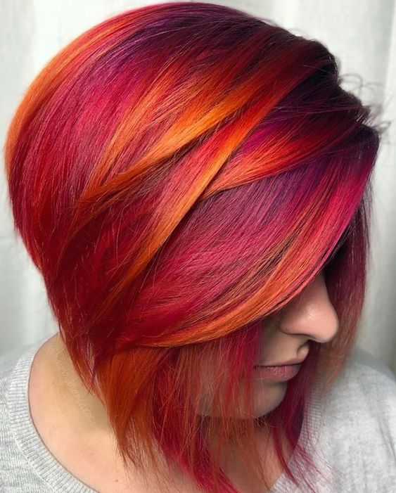 Girl with pink hair with orange and red