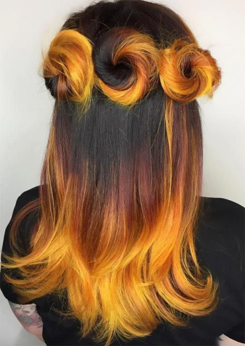 Girl with bun hairstyle and loose orange and yellow hair