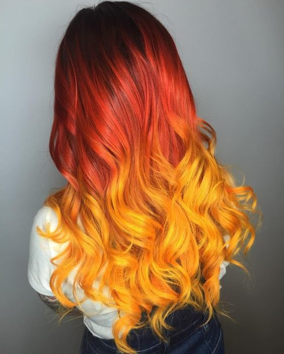 Girl with long red and yellow hair on the tips