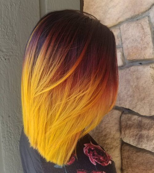 Girl with hair degraded from red to yellow