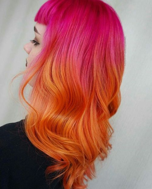 Girl with half orange half pink hair