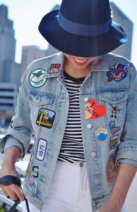 Custom denim jacket with patches of different types
