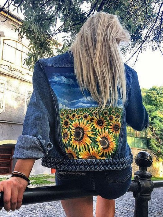 Custom denim jacket with a painting of a sunflower field on the back