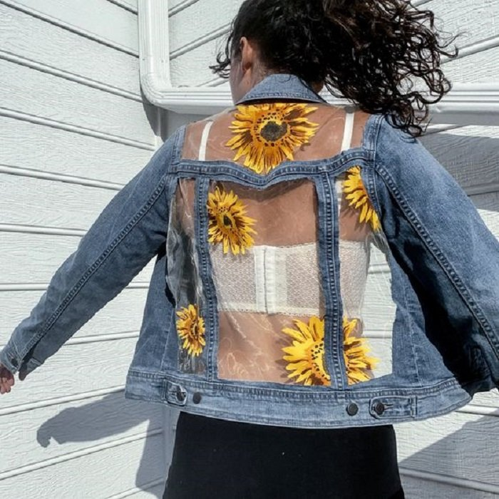 Custom denim jacket with transparent areas and painted sunflowers