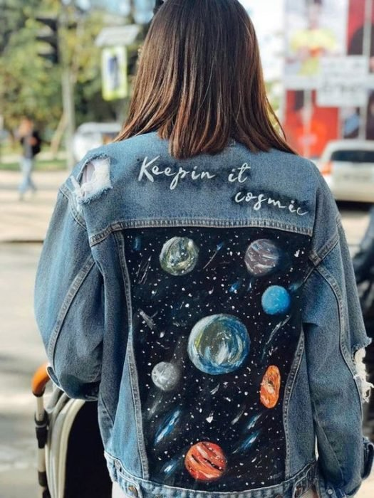 Customized denim jacket with the solar system in the back area
