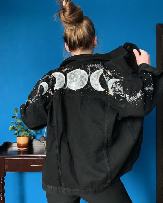 Custom denim jacket with the phases of the moon in the upper part of the back