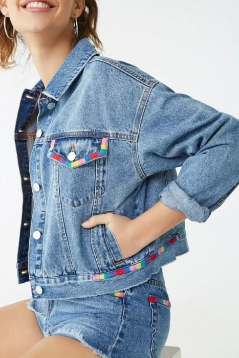 Custom denim jacket with embroidered details in rainbow tones