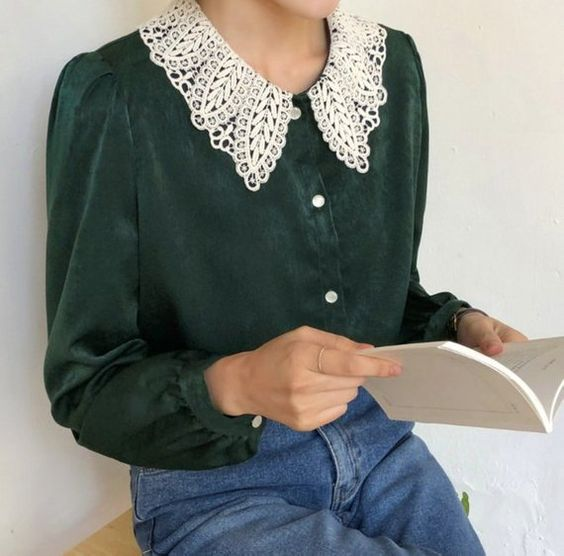 Girl in emerald green blouse with white baby collar