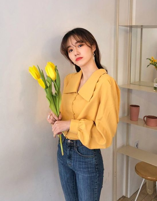 Asian girl in yellow blouse with bobo neck
