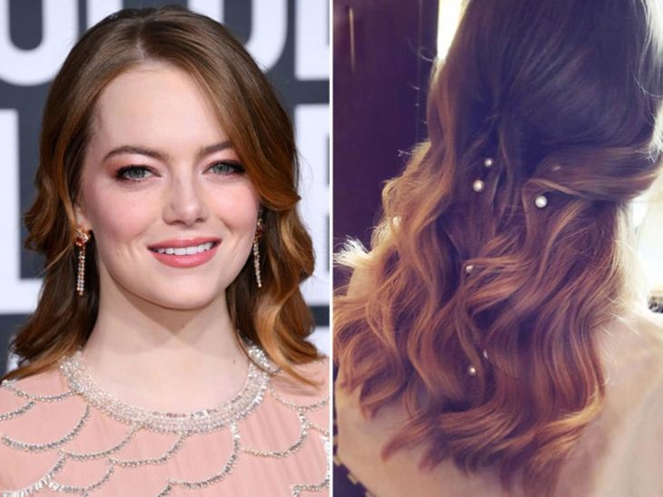 Emma Stone showing her semi-collected hair and adorned with pearls in her hair