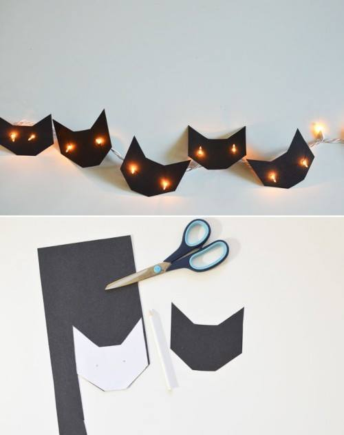 Gatitos de papel negro con luces