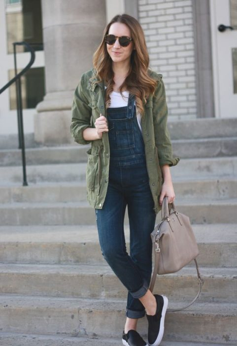 Long brown hair girl in white blouse, overalls and long green jacket bound