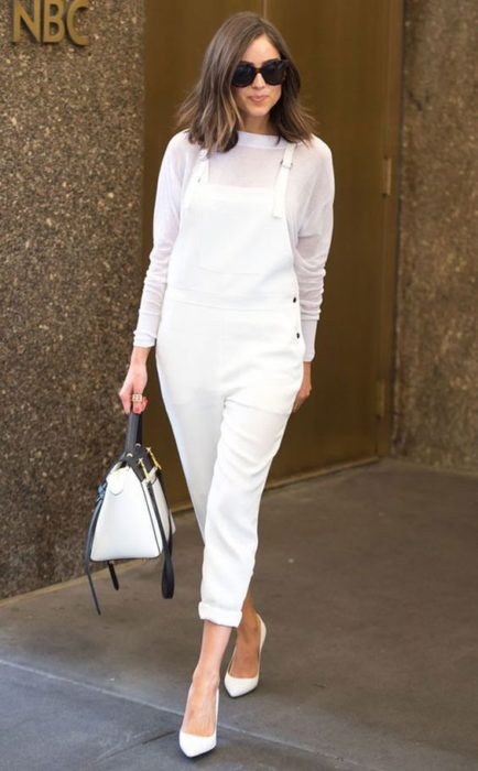 Girl in white blouse, bag and overalls