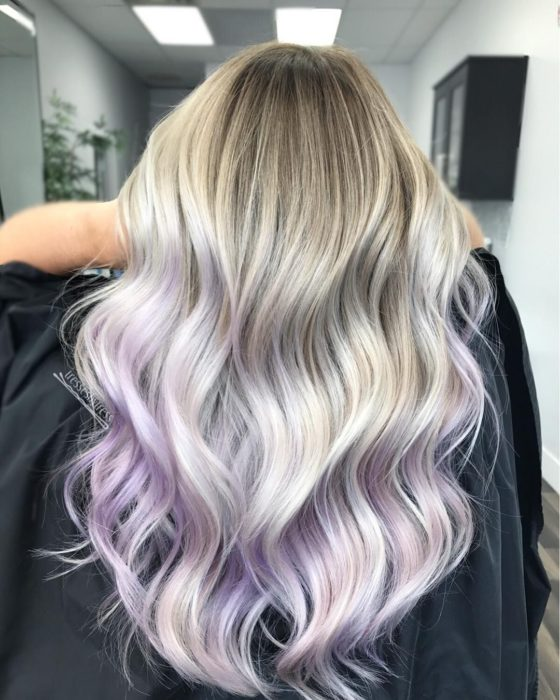 Girl with lavender dyed hair with a combination of blonde