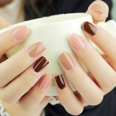 Manicure in pink and wine colors
