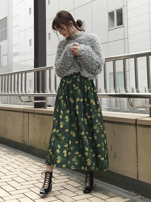 Asian girl with gray supeter and green skirt with flowers