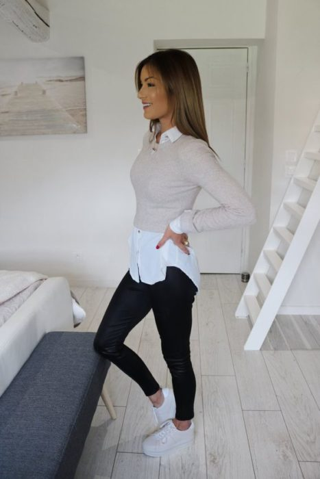 Girl wearing black jeans, white tennis shoes, white shirt and beige crop top supeter