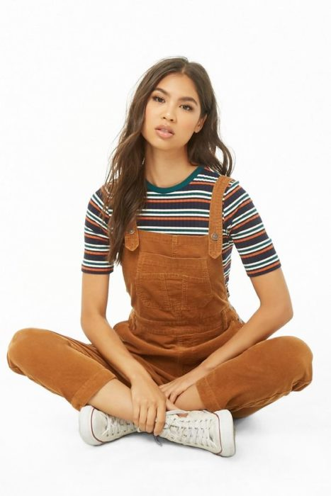 Girl wearing camel color overalls and short sleeve round neck striped blouse