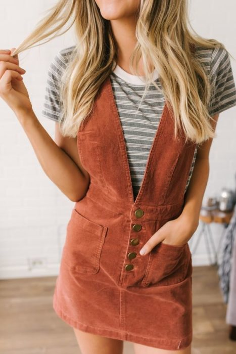 Corduroy dress-style outfit with deep V-neckline and short-sleeved round-neck striped blouse