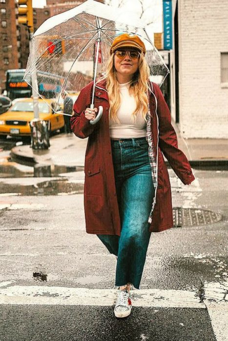 Curvy girl wearing tennis shoes with green straight pants with white top and burgundy jacket