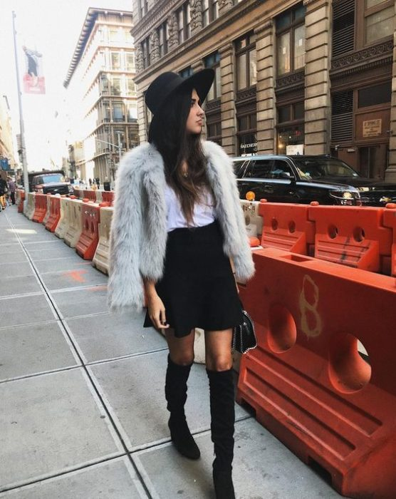 Loose long hair girl with hat, blsa blancs, denim jacket and black skirt