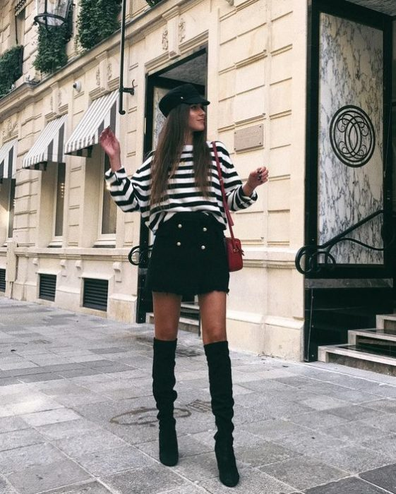 Long hair girl with black skirt and white striped blouse with black and hat