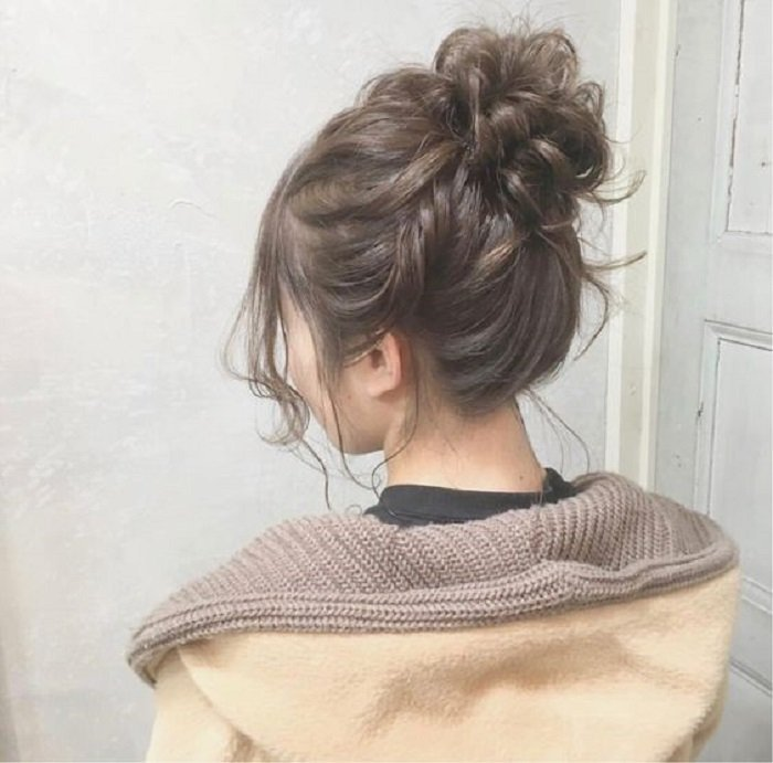 Girl with tousled high bun