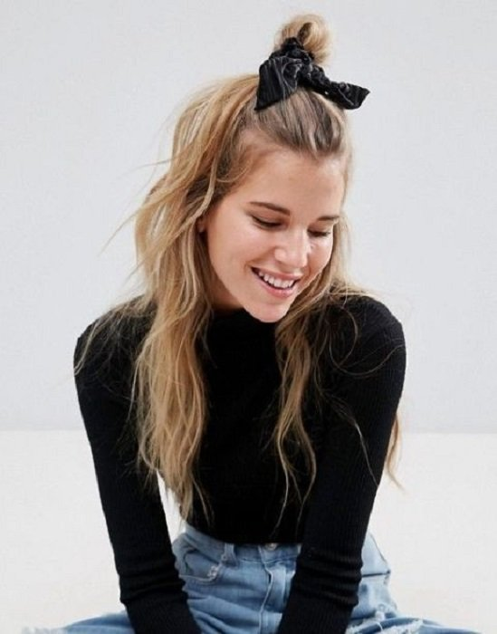 Girl combed with a bun with black scrunchie